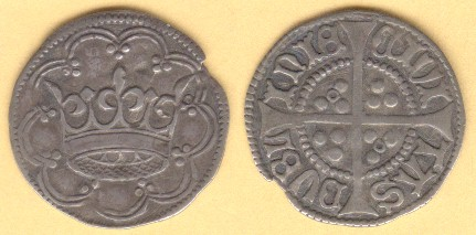 Two ancient Irish coins sit on a beige background.